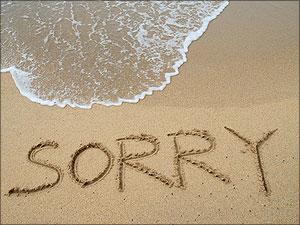 sorry in het zand geschreven